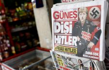 epa05853742 Turkish Gunes newspaper seen with a headline 'Female Hitler, Ugly Aunt' depicting a picture of German Chancellor Angela Merkel as Adolf Hitler, in Istanbul, Turkey, 17 March 2017. Tension between Germany and Turkey took a new turn after the cancellation of campaigning events of Turkish government members in Germany, to approve a constitutional change in Turkey, on which the Turks will vote in a referendum on 16 April 2017. The change to a presidential system proposed by the AKP-party dominated government, is intended to give the President of Turkey far reaching powers.  EPA/SEDAT SUNA