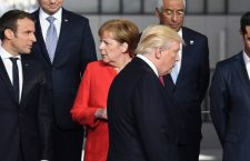French President Emmanuel Macron (L) and German Chancellor Angela Merkel (2nd L) speaks as US President Donald Trump (C) arrives next to Greek Prime Minister Alexis Tsipras (R) for a family picture during the NATO (North Atlantic Treaty Organization) summit at the NATO headquarters, in Brussels, on May 25, 2017. / AFP PHOTO / Eric FEFERBERG        (Photo credit should read ERIC FEFERBERG/AFP/Getty Images)