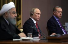 epa06344220 Russian President Vladimir Putin (C), Iranian President Hassan Rouhani (L) and Turkish President Recep Tayyip Erdogan (R) attend a joint news conference following their meeting in the Black sea resort of Sochi, Russia, 22 November 2017. Leaders of Russia, Turkey and Iran meet in Sochi to discuss settlement  of the situation in Syria.  EPA/MICHAEL KLIMENTYEV / SPUTNIK / KREMLIN POOL MANDATORY CREDIT