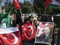 Palestinian supporters of the Hamas movement hold portraits of Turkish President Recep Tayyip Erdogan as they shout slogans against the military coup attempt in Turkey, during a demonstration in Gaza City, on July 17, 2016. Turkish authorities wrested back control of the country on July 16, after crushing a military coup by discontented soldiers seeking to seize power from President Recep Tayyip Erdogan that claimed more than 250 lives. / AFP PHOTO / MAHMUD HAMS