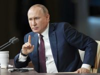 """Russian President Vladimir Putin gestures during his annual news conference in Moscow, Russia, Thursday, Dec. 19, 2019. Putin said Thursday that U.S. President Donald Trump was impeached for """"far-fetched"""" reasons, calling the move by Democrats a continuation of their fight against the Republican leader. (AP Photo/Pavel Golovkin)"""